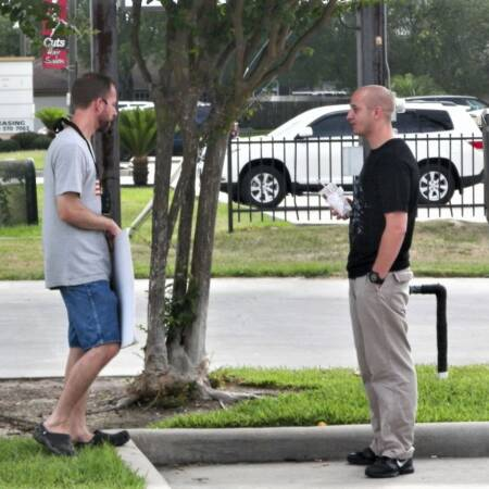 Man talking to male client at PP Resized (2)