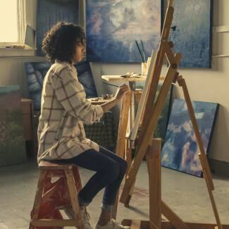 woman-sitting-on-brown-stool-374054