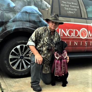 Hank kneeling with dog